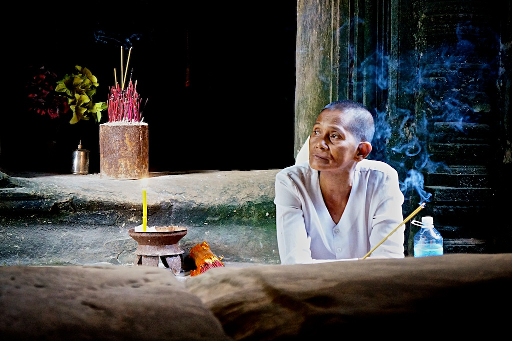 Lady selling incense at a temple in Angkor, Siem Reap, Cambodia