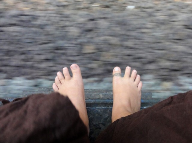 my feet on a moving Indian train