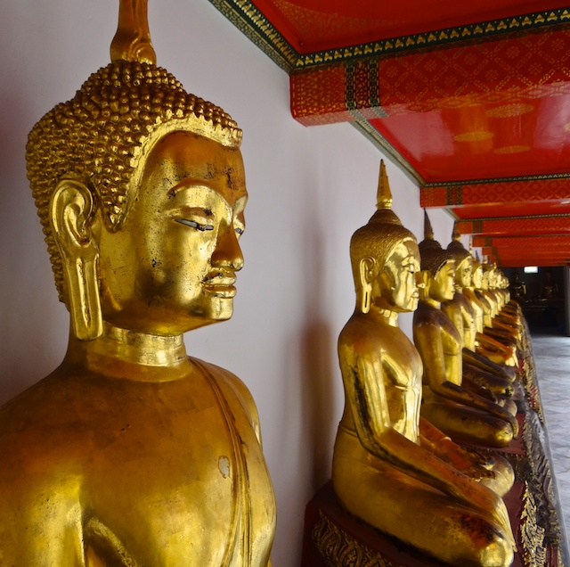 Row of Golden Buddhas in Wat Po, Bangkok Thailand