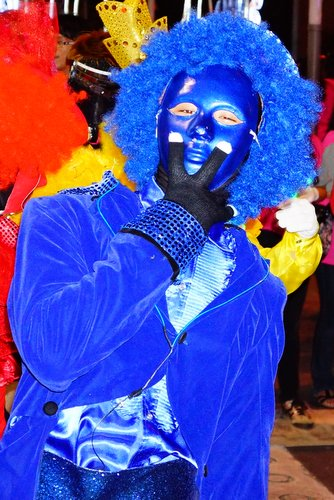Blue costume and mask at a carnival celebrating a shopping centre opening in KL Malaysia