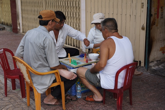 Some of the only people left in Chinatown during Tet - playing Ludo