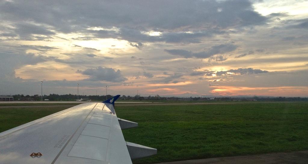 Laos Vientiane airport sunset on runway