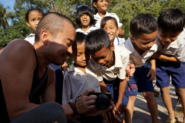 Cambodian school kids looking at at camera