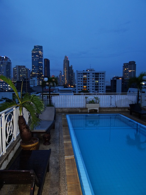 dusk cityscape with pool in foreground - Bangkok, Thailand