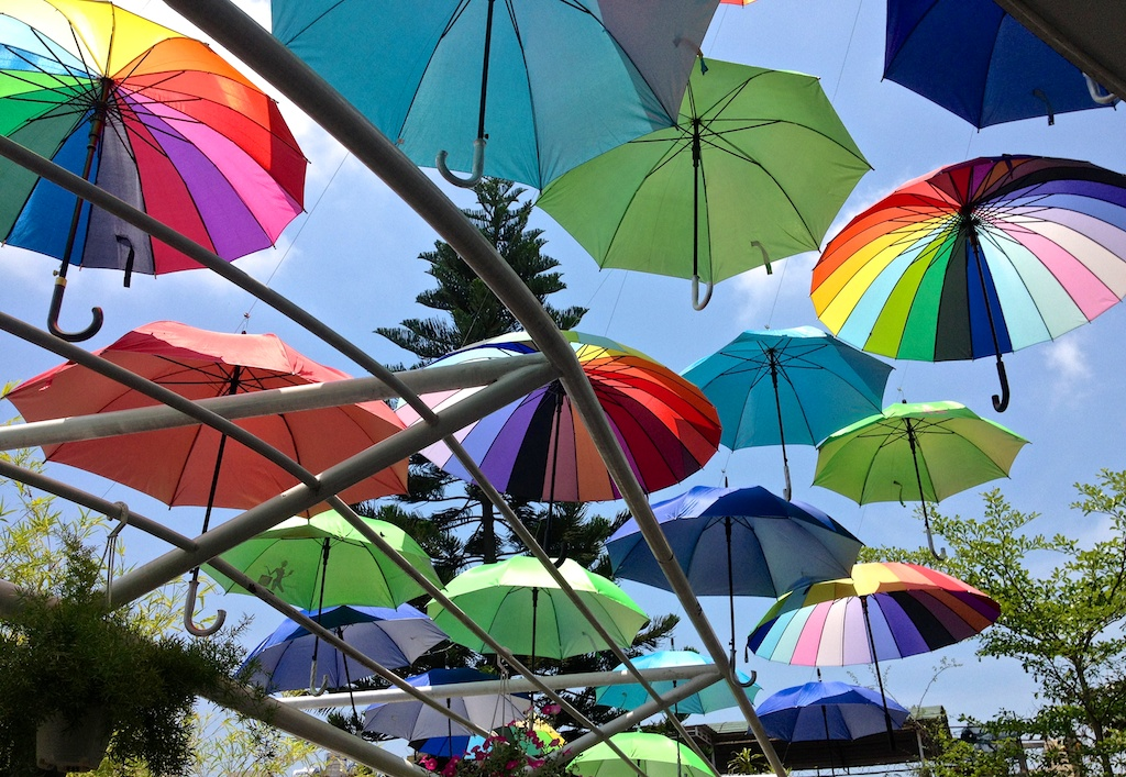 coffee shop terrace in Vietnam using colourful umbrellas as shade