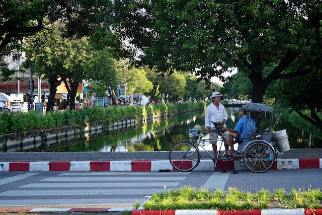 Men meeting in the late afternoon on Chiang Mai's eastern moat