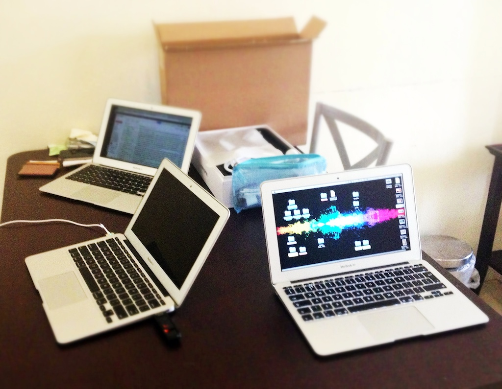 3 macbook airs on a table