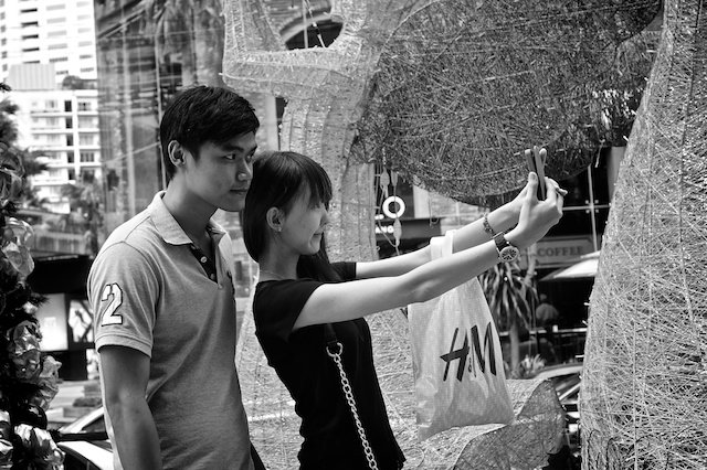 Couple taking Christmas pic KL