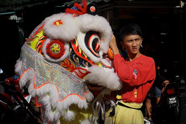 Lion dance performer getting ready