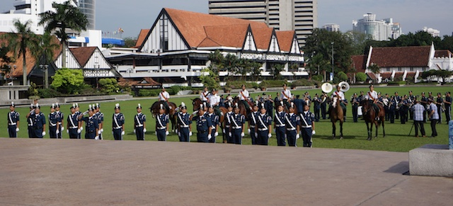 Saluting the flag in Merdeka Square