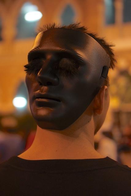 Mask on backwards at Turun rally in KL NYE 2013