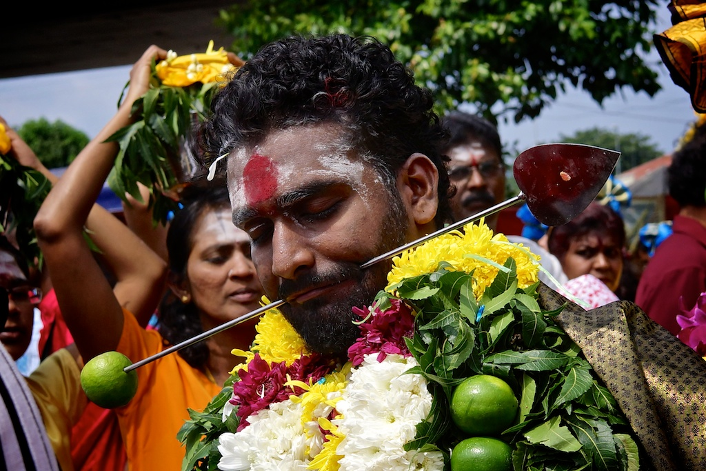 Man with a face piercing at Thaipusam celebrations at Batu Caves 2014