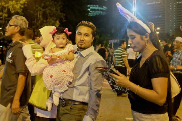 Family at Dataran Merdeka to enjoy the show NYE 2013 in KL