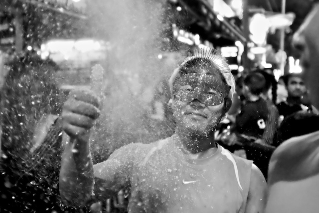 Mask wearer gets sprayed in Bukit Bintang, KL 24th December 2013