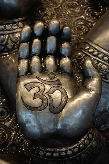 Om on Ganesh's hand