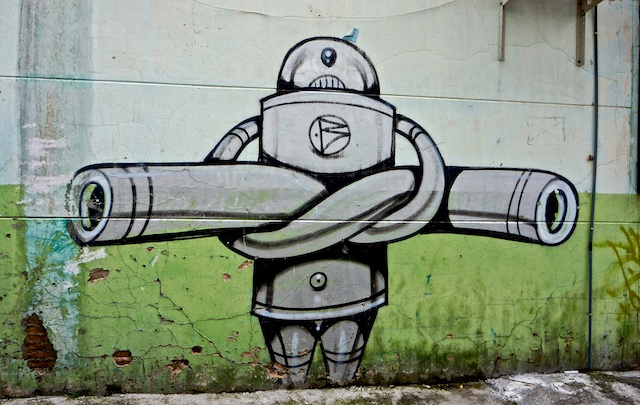 Crossed arm robot street art Chiang Mai