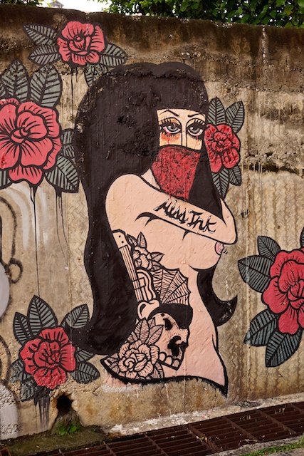 Topless lady with flowers at  Kad Suan Kaew, Chiang Mai street art