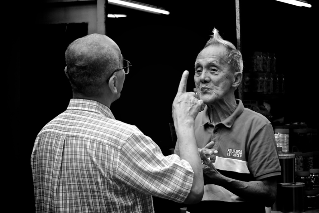 two men chat daily photo - street photography
