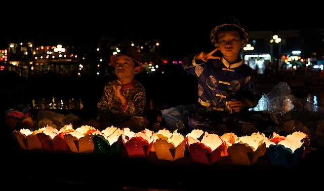 Children selling lanterns in Hoi An, Vietnam
