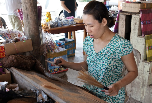 hand rolling incense outside Hue, Vietnam