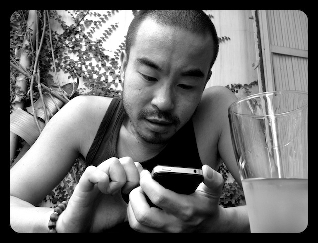 black and white of Henry on his phone