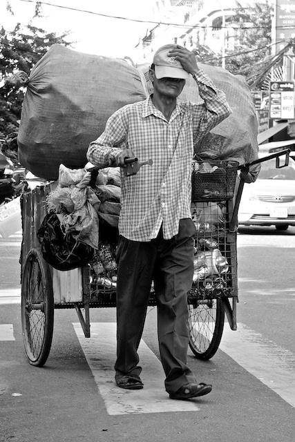 b&w rubbish collector, Cambodia