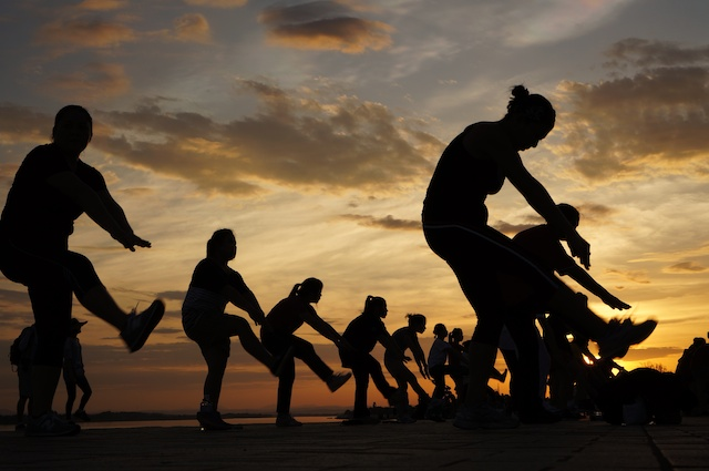 Outdoor fitness class at sunset in Vientiane
