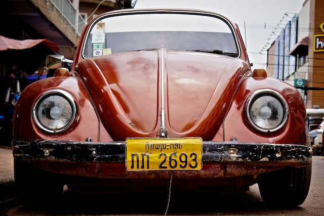 Front shot of classic VW Beetle dark red/orange colour