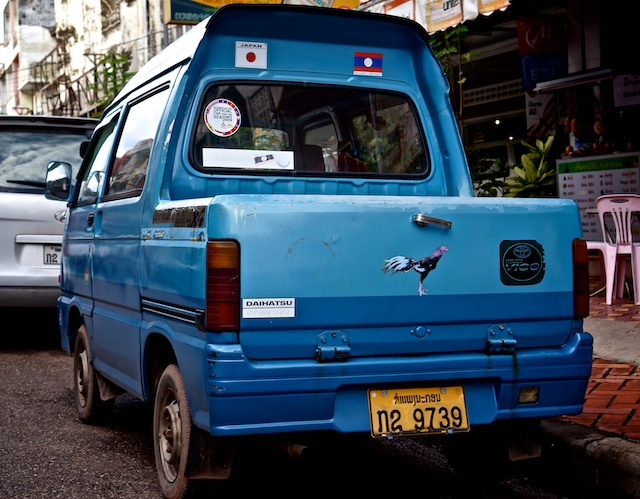 blue mini bus turned into a pick-up truck