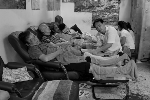 B+W men enjoying foot massage