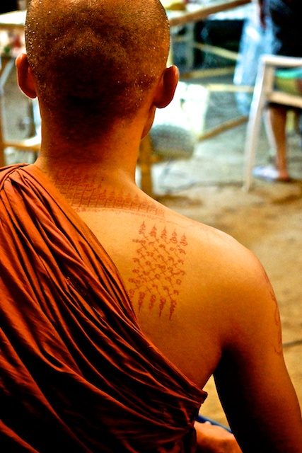 tatoo on the shoulder of a monk in Chiang Mai, Thailand in Wat Phan Tao