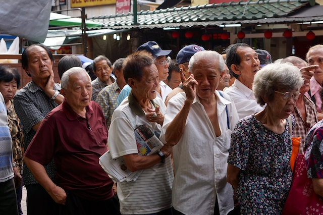 Older people queue for free Tangyuan at Dongzhi in Kuala Lumpur