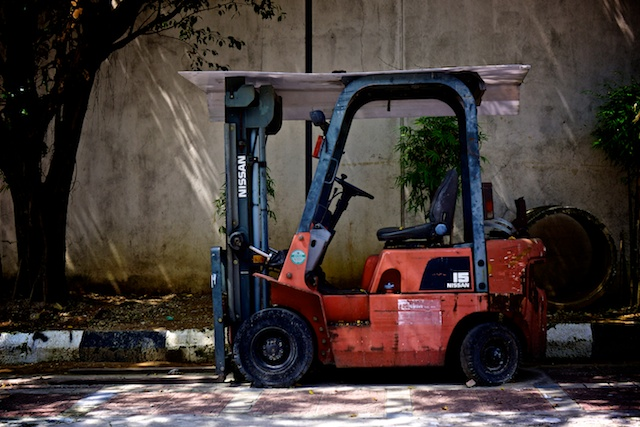 Blue and red forklift truck