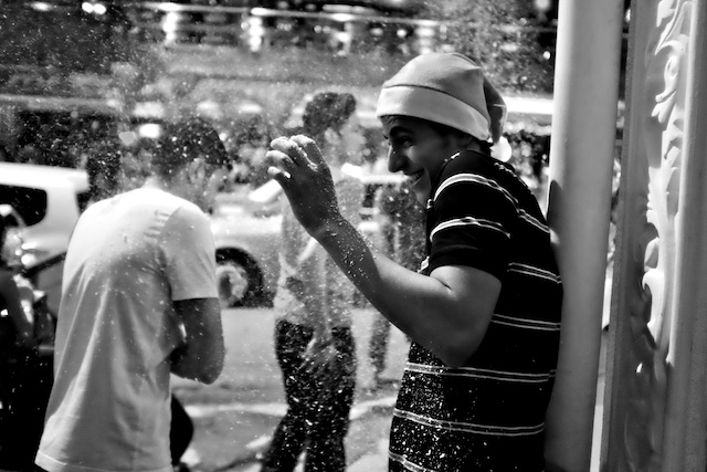 reveller gets sprayed with snow Bukit Bintang Christmas Eve 2013