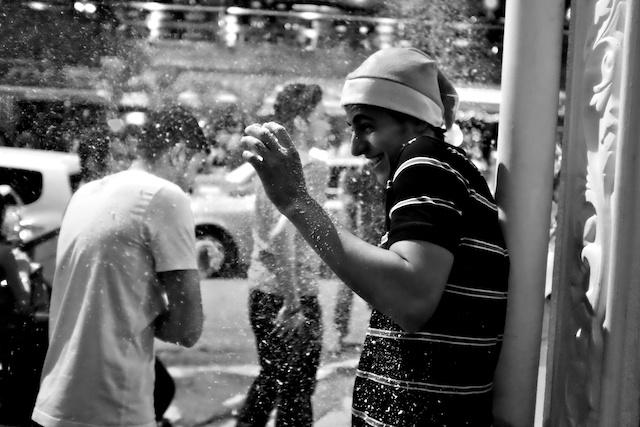 reveller gets sprayed with snow Bukit Bintang Christmas Eve 2013