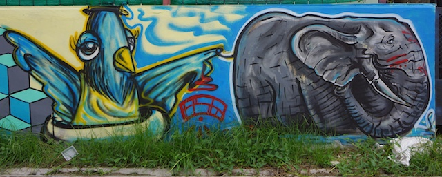 Elephant with a bird holding tail - street art in CM