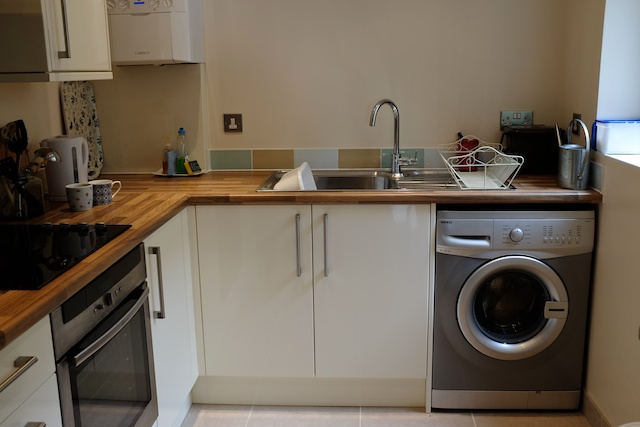 Our new kitchen that came with a washing machine